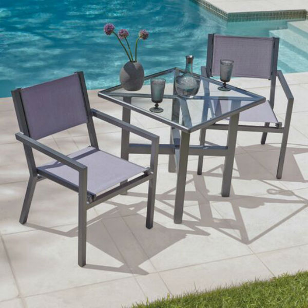 Palm Coast Sling Dining Collection By Woodard Outdoor Patio Furniture Family Leisure