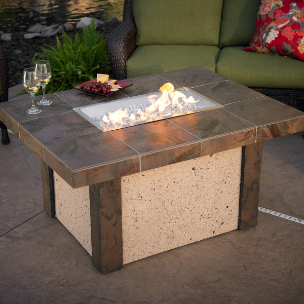 the rivers edge fire pit table by the outdoor greatroom