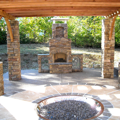 A Ceremony-Ready Outdoor Room with Custom Stone Fireplace & Wood Pergola