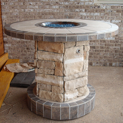 Outdoor Custom Stone Gas Fire Pit Serves As an Exotic Central Focal Point